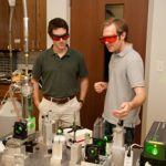Students discuss the optical experiment